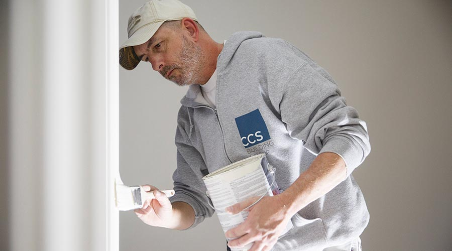 CCS employee painting interior walls