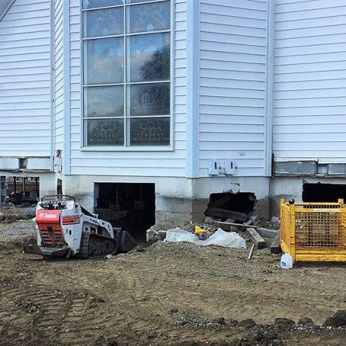 Digging up the original chapel foundation prior to relocation