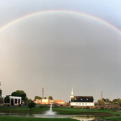 A rainbow arches over the new Willow Valley chapel location